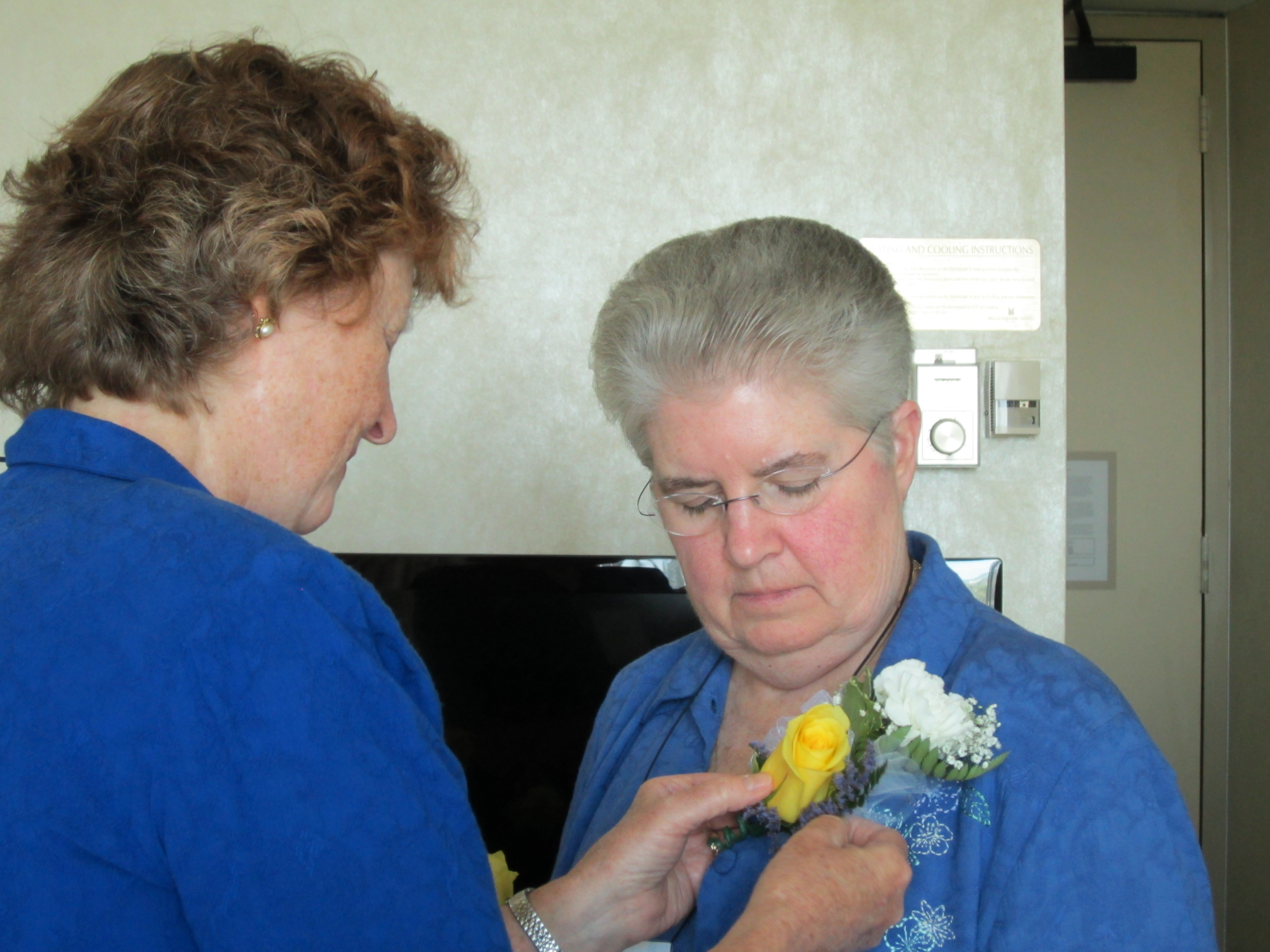 Sr. Carol Zinn receiving flowers at the LCWR Assembly in Aug. 2012.